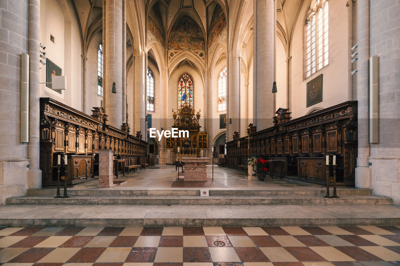 architecture, built structure, building, religion, arch, place of worship, belief, spirituality, flooring, tile, indoors, tiled floor, architectural column, day, arcade, the past, aisle, ceiling