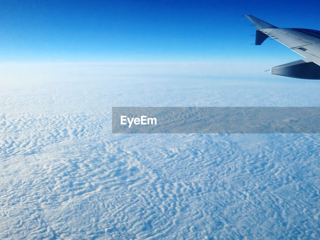 airplane, aerial view, flying, nature, landscape, airplane wing, journey, scenics, beauty in nature, transportation, air vehicle, aircraft wing, tranquil scene, sky, no people, outdoors, travel, tranquility, day, blue, winter, snow, cold temperature, clear sky