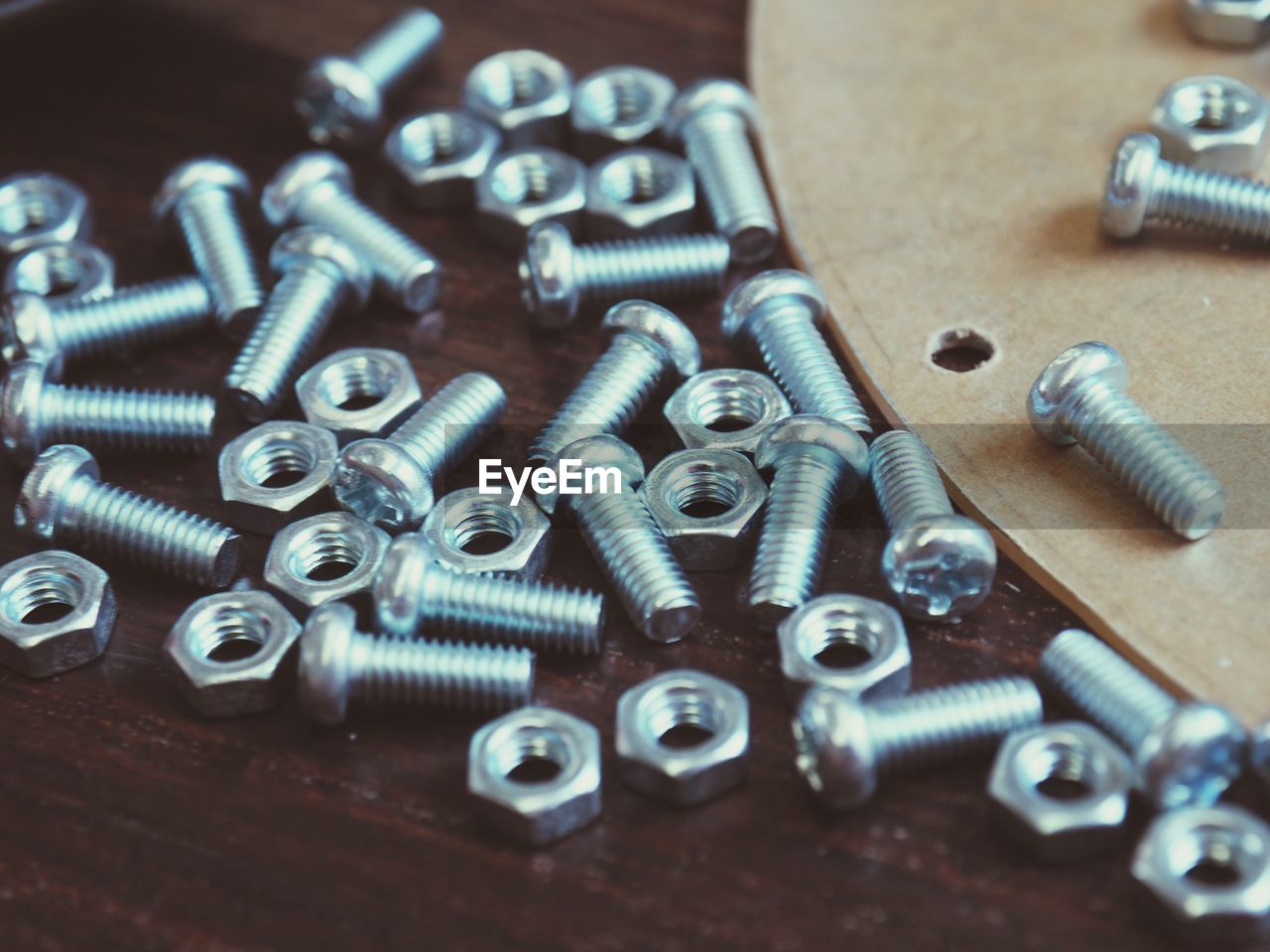 screw, metal, bolt, close-up, equipment, large group of objects, nut - fastener, selective focus, no people, still life, industry, indoors, high angle view, work tool, table, abundance, silver colored, focus on foreground, pattern, nut, iron - metal, steel