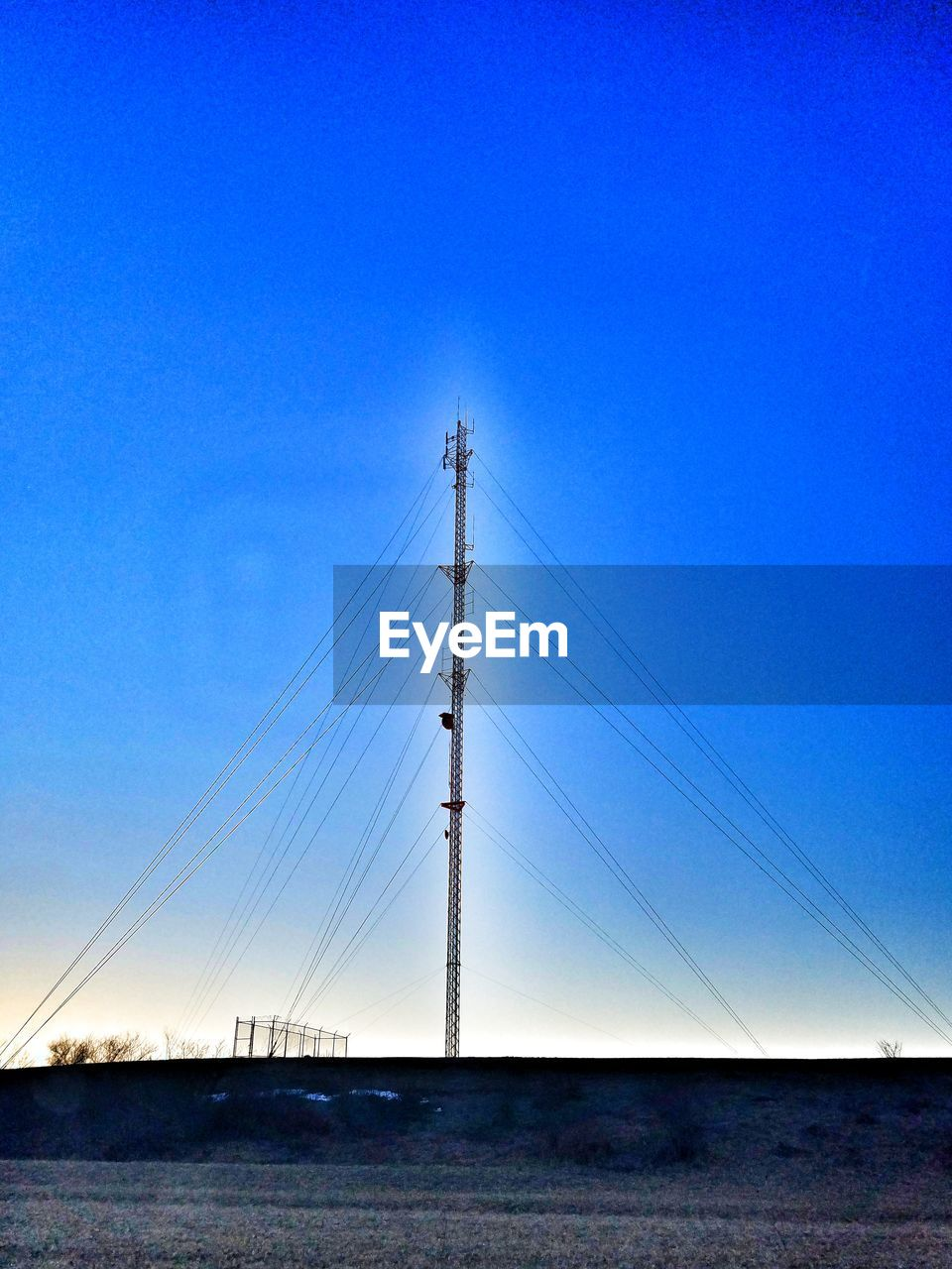 blue, connection, cable, clear sky, no people, outdoors, copy space, day, electricity, nature, electricity pylon, low angle view, sky, vapor trail