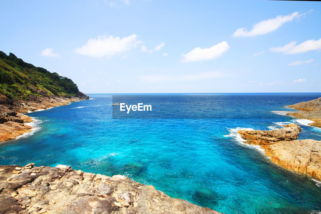 sea, scenics - nature, sky, beauty in nature, water, tranquil scene, tranquility, land, cloud - sky, horizon over water, idyllic, horizon, blue, beach, rock, nature, solid, no people, day, outdoors, turquoise colored, rocky coastline