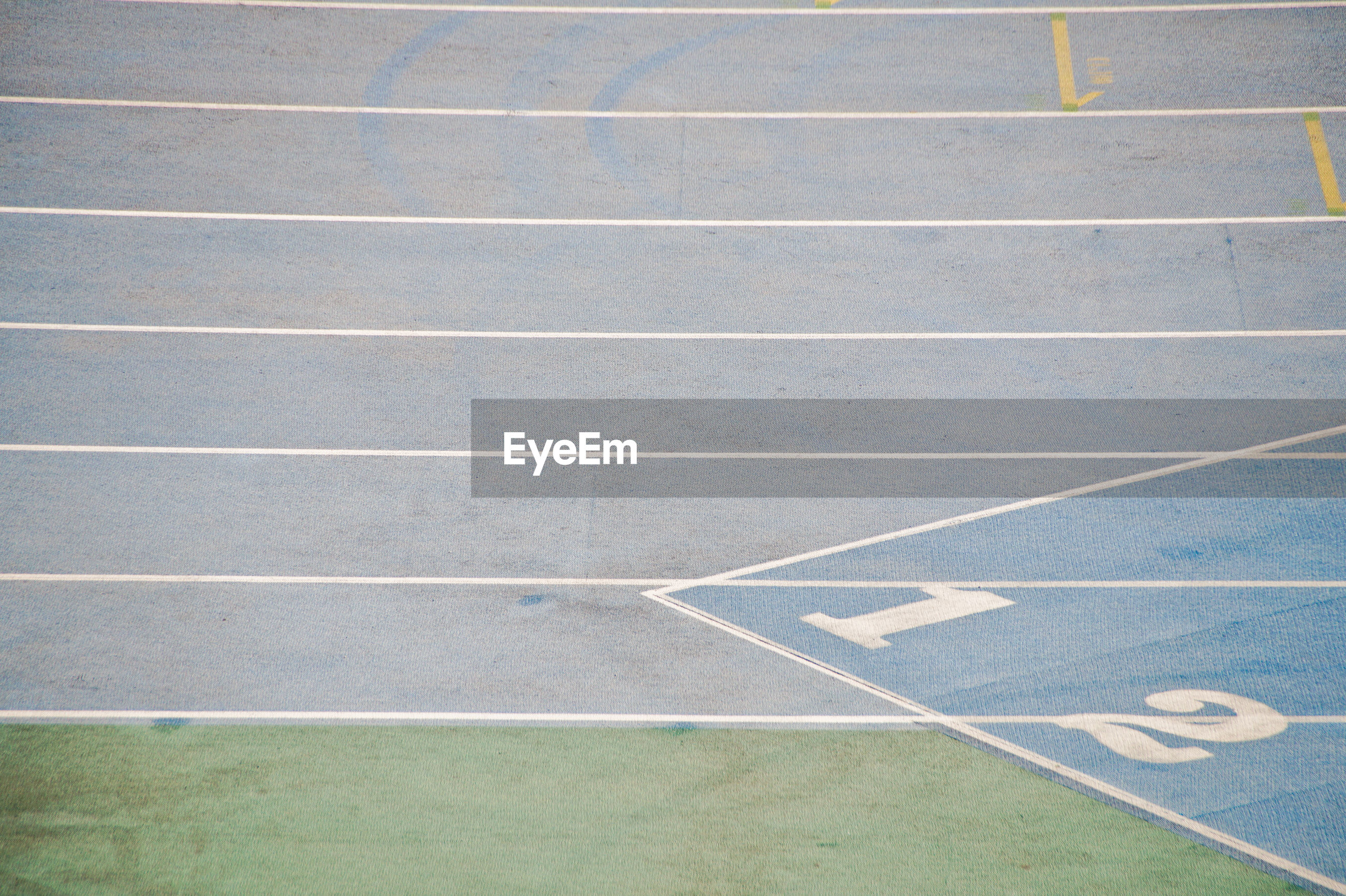 High angle view of running track with numbers in stadium
