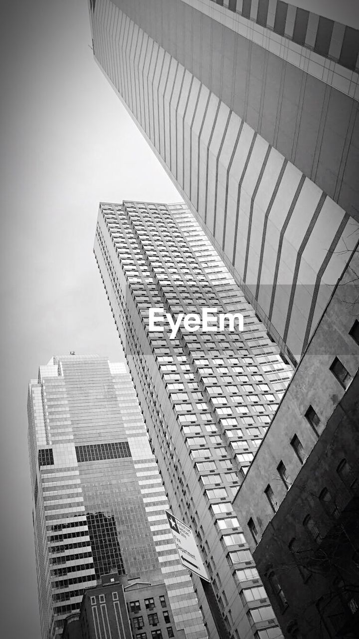 architecture, skyscraper, building exterior, built structure, low angle view, city, no people, outdoors, modern, day, sky