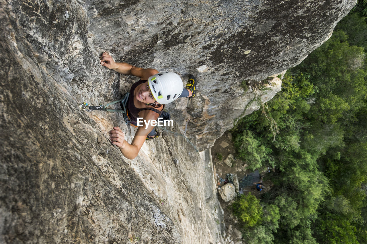 climbing, extreme sports, sport, rock climbing, adventure, safety, rock - object, strength, solid, rock, helmet, challenge, protection, activity, risk, sports helmet, determination, rope, full length, vitality, safety harness, effort, hand, skill, rock face, outdoors