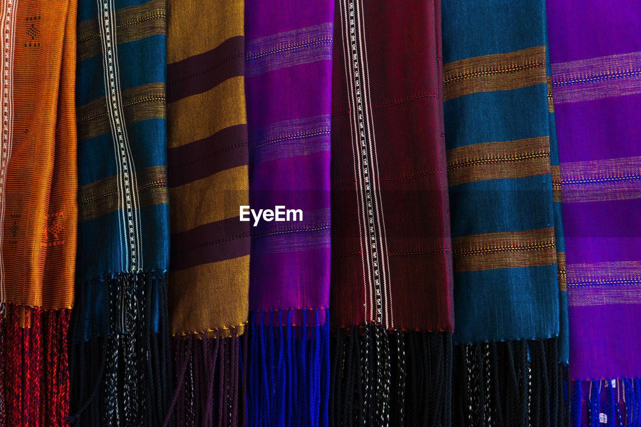 Full frame shot of colorful scarves hanging for sale at market