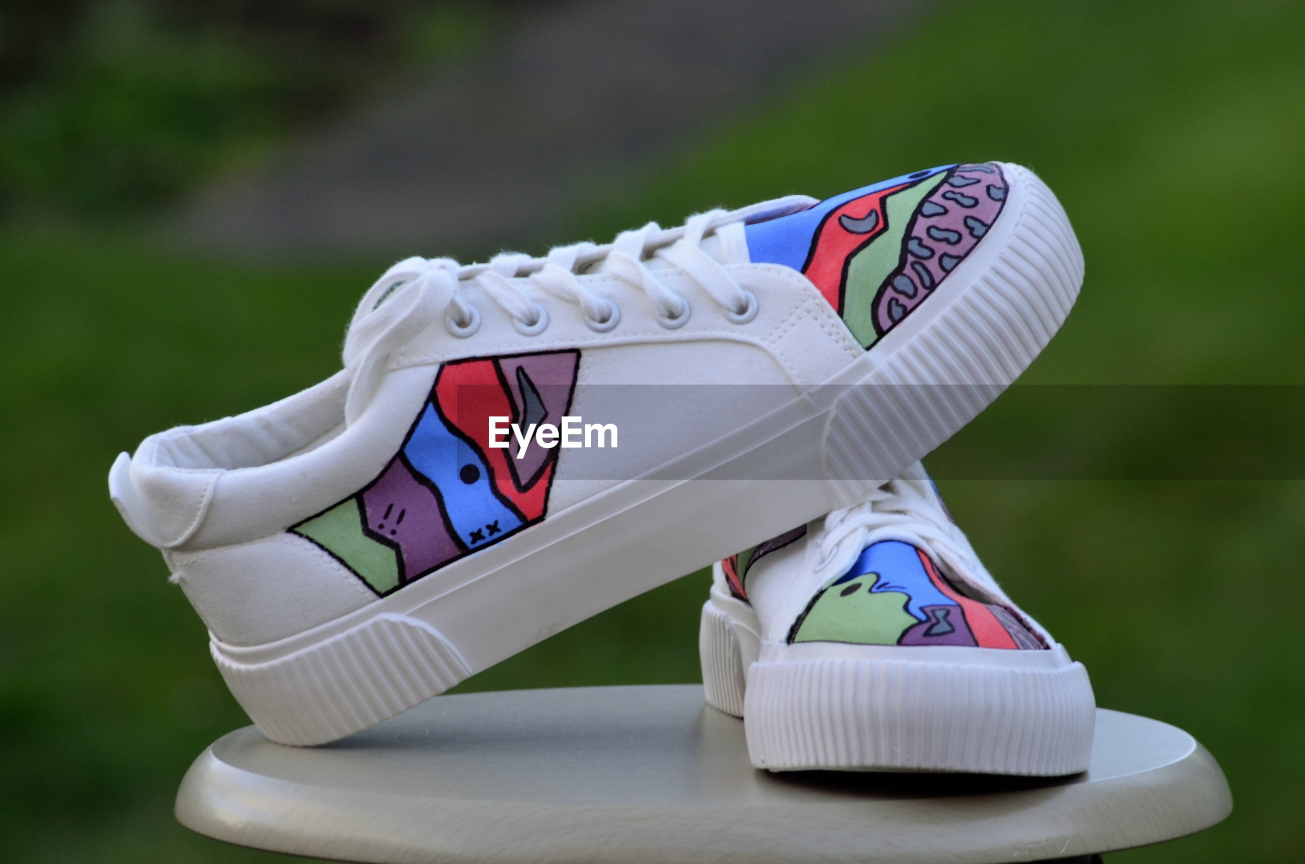 CLOSE-UP OF WHITE SHOES ON TOY