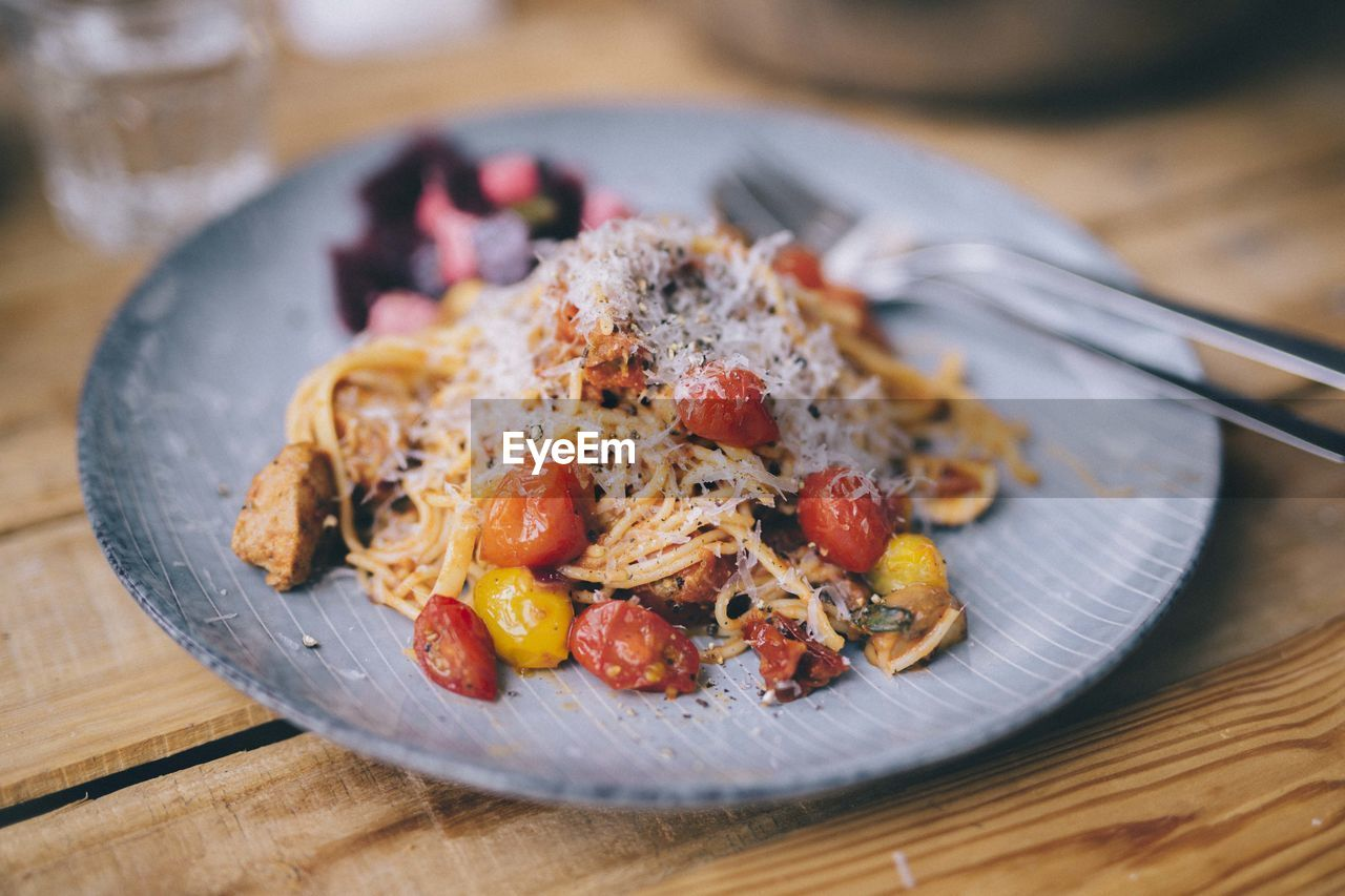 food, food and drink, ready-to-eat, table, freshness, kitchen utensil, plate, indoors, serving size, healthy eating, eating utensil, close-up, still life, wellbeing, fruit, no people, wood - material, meal, vegetable, focus on foreground, breakfast, temptation, spaghetti, dinner