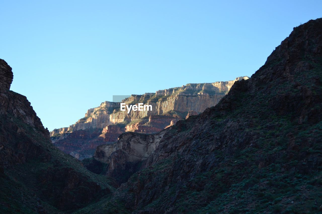 Low Angle View Of Rocky Mountains At Grand Canyon National Park Against Clear Sky