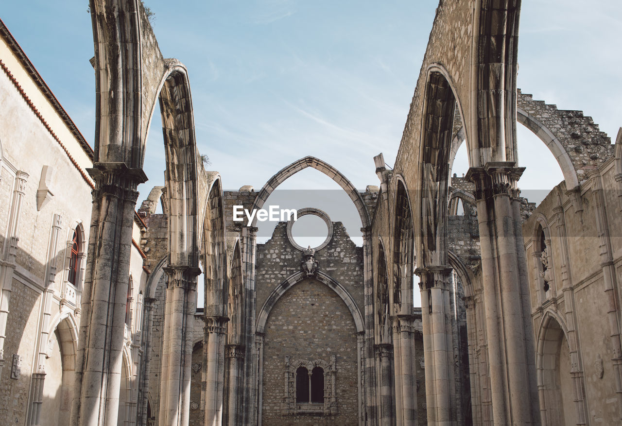 architecture, built structure, arch, building exterior, place of worship, religion, sky, history, the past, spirituality, building, belief, low angle view, travel destinations, day, tourism, no people, nature, outdoors, architectural column, ancient civilization, gothic style, abbey, ornate