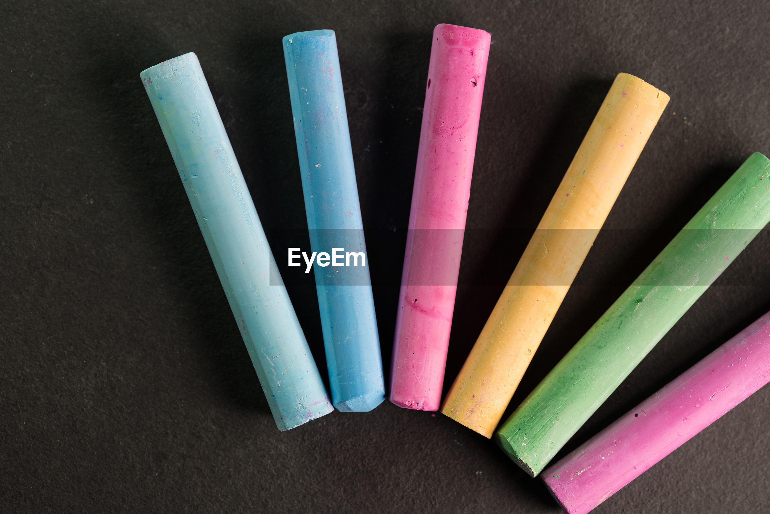 Close-up of colorful chalks arranged on table