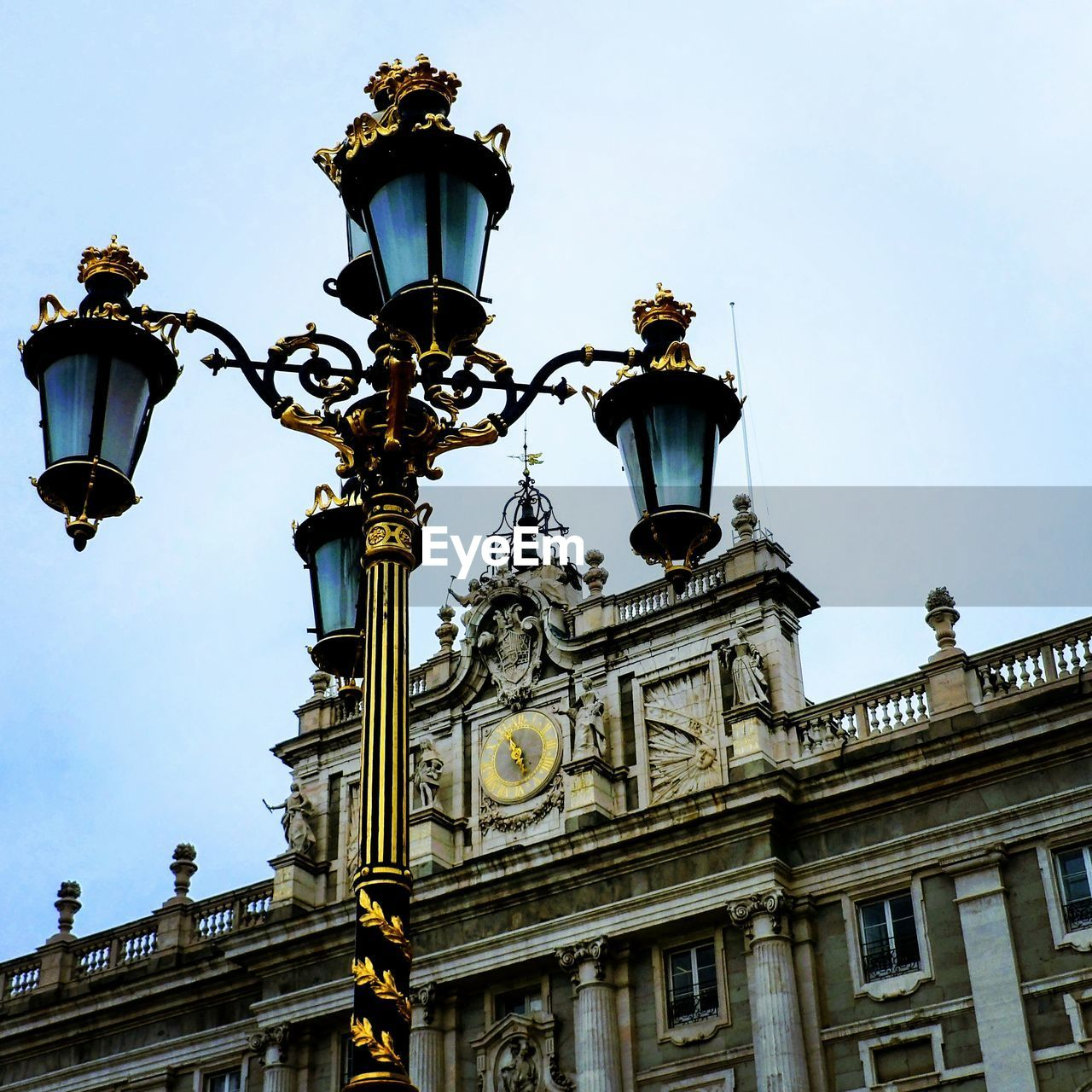 street light, low angle view, sky, lighting equipment, built structure, street, architecture, building exterior, nature, history, no people, the past, day, clear sky, city, outdoors, travel destinations, building, ornate, architectural column, antique