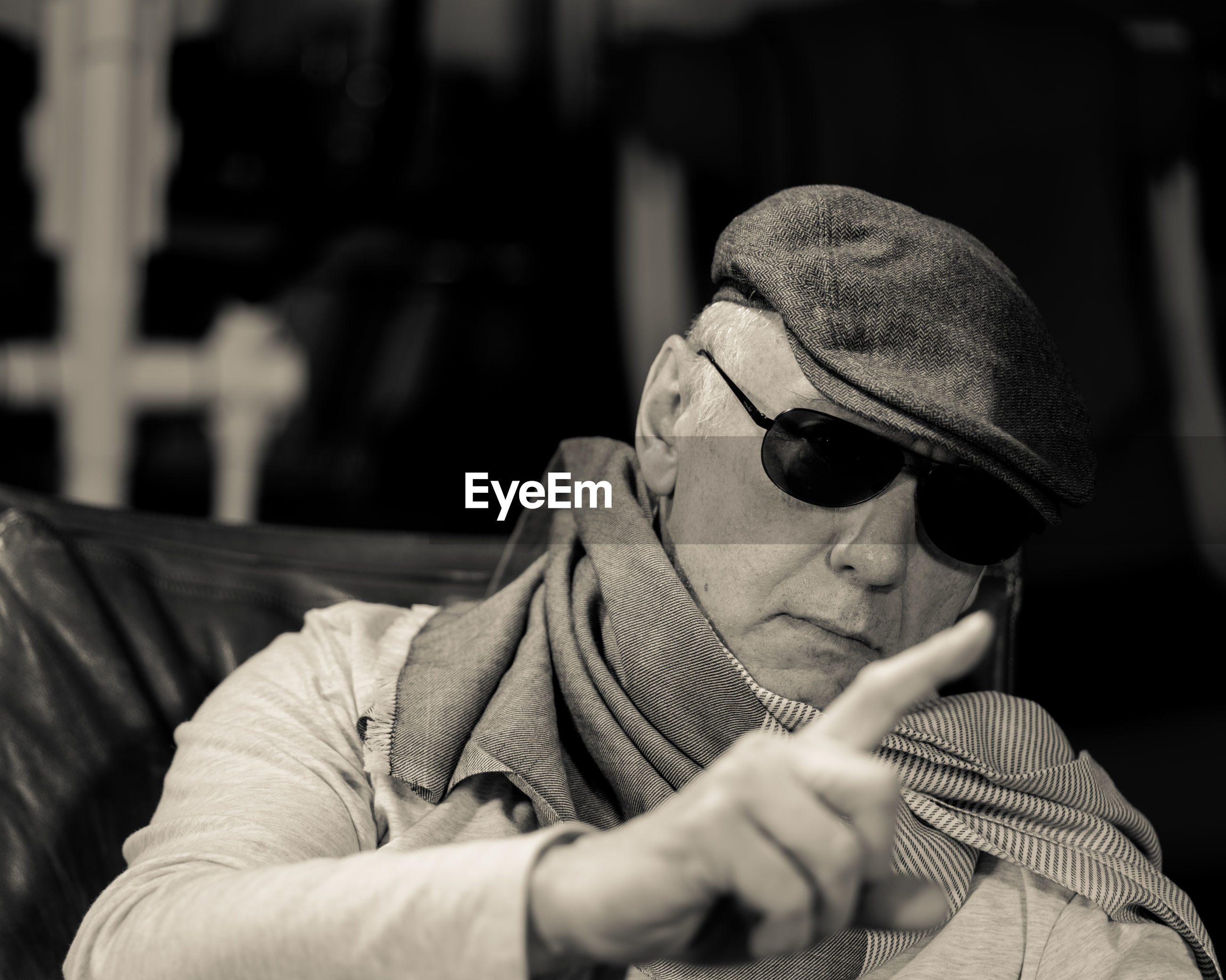 Man wearing sunglasses while sitting on chair