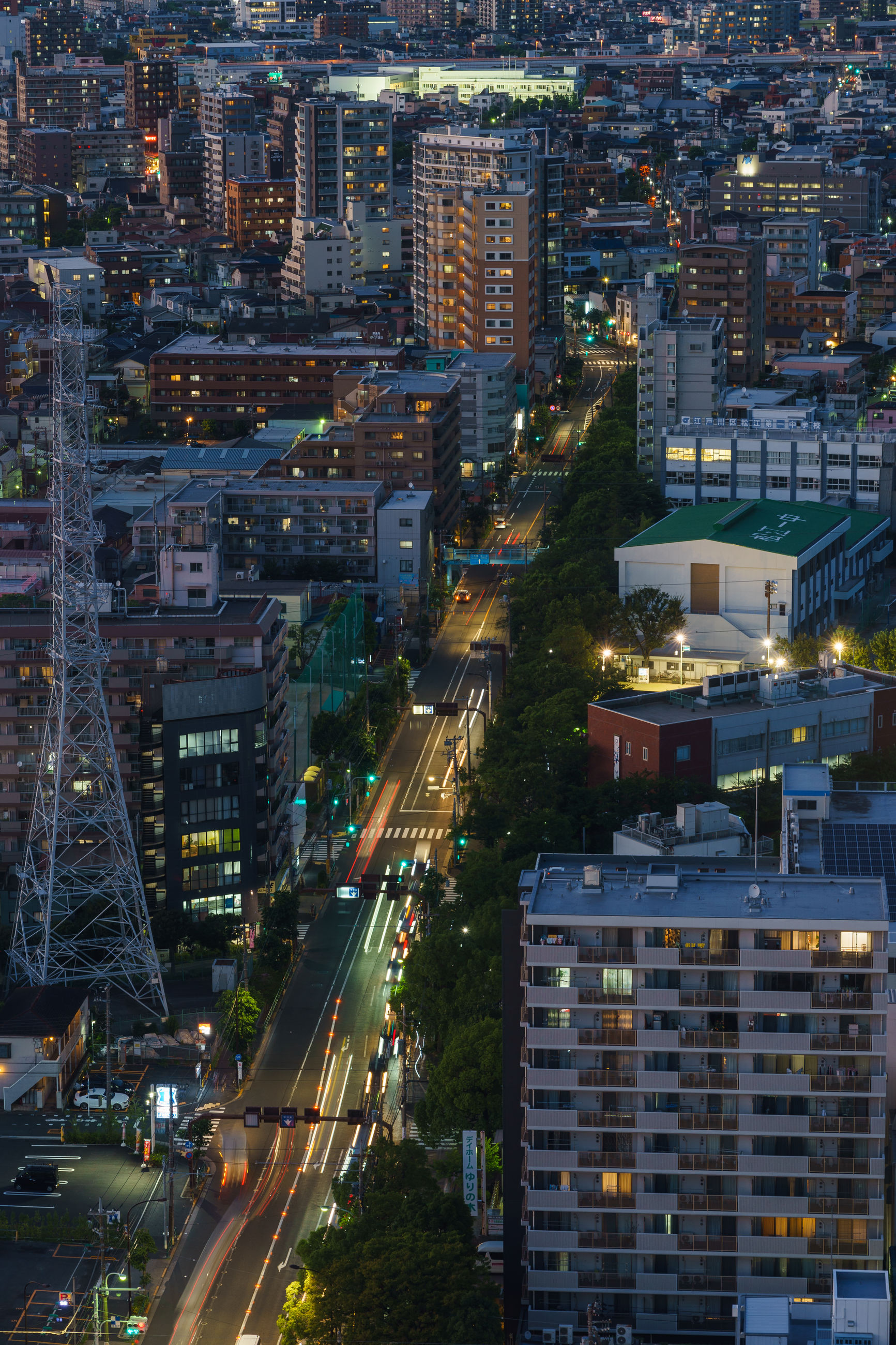 Aerial view of illuminated buildings in city at dusk