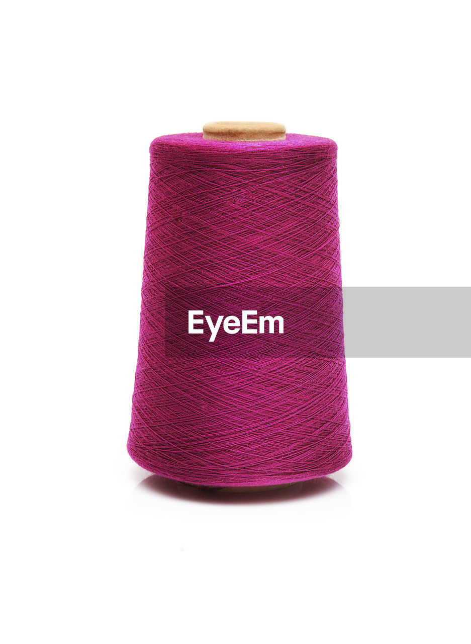 white background, studio shot, indoors, thread, art and craft, pink color, close-up, no people, textile, still life, cut out, spool, wool, multi colored, sewing item, copy space, craft, purple, single object, material, softness