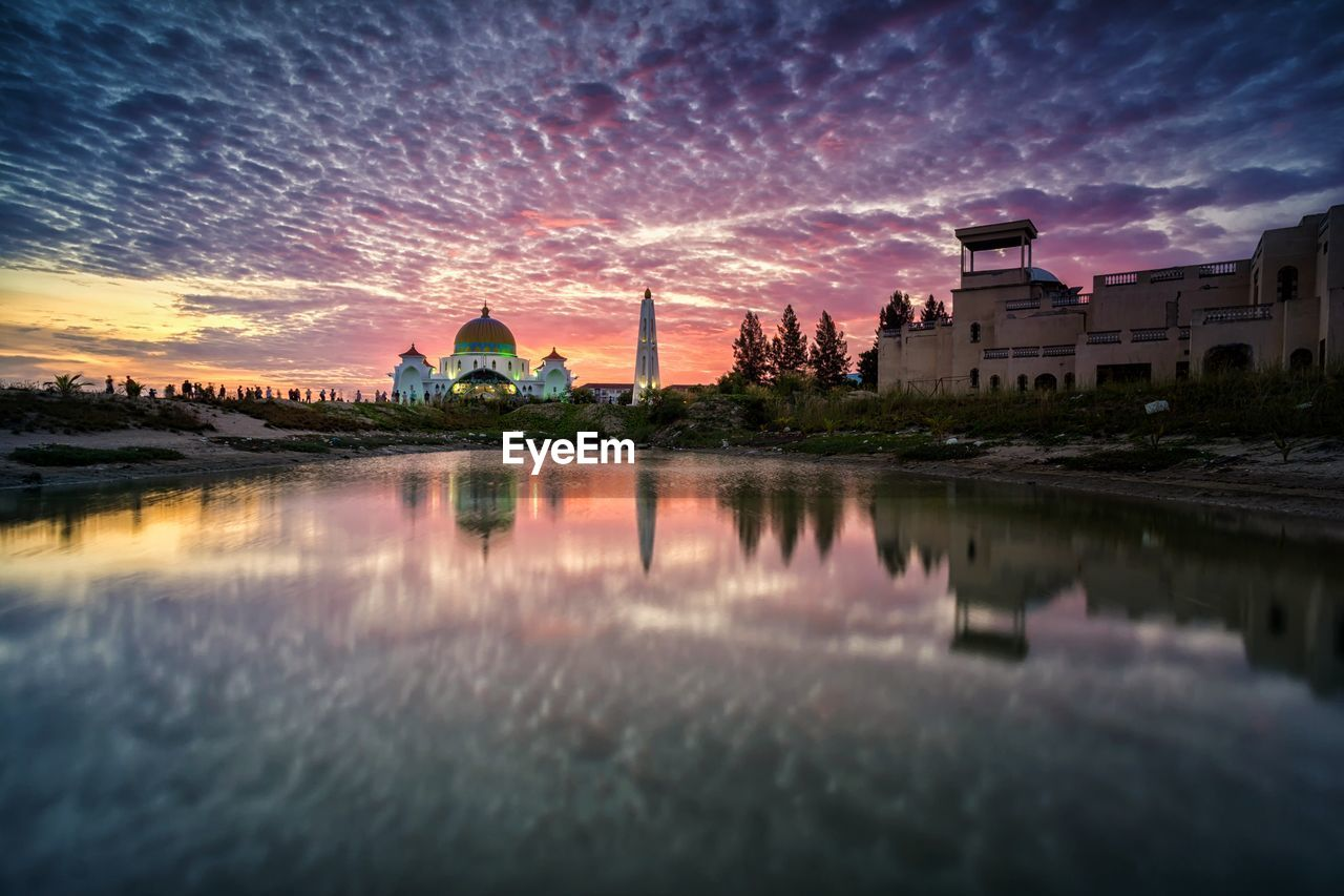 architecture, built structure, building exterior, building, water, sky, reflection, place of worship, belief, religion, cloud - sky, no people, nature, sunset, city, waterfront, spirituality, travel destinations, lake, outdoors