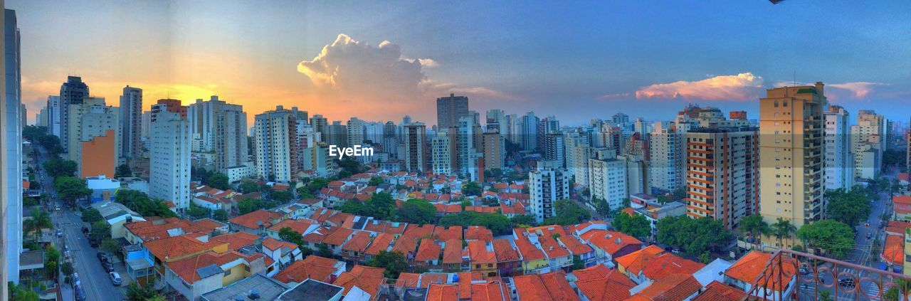 building exterior, architecture, built structure, city, sky, building, cityscape, cloud - sky, office building exterior, urban skyline, skyscraper, residential district, nature, panoramic, crowded, modern, high angle view, sunset, landscape, outdoors, financial district