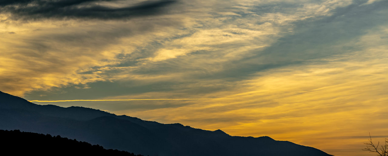 sky, cloud - sky, beauty in nature, sunset, mountain, scenics - nature, silhouette, tranquility, tranquil scene, nature, orange color, mountain range, idyllic, no people, non-urban scene, outdoors, environment, dramatic sky, landscape, low angle view, mountain peak