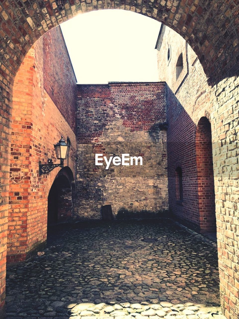 architecture, brick, arch, built structure, brick wall, wall, building, no people, indoors, wall - building feature, day, entrance, old, history, door, the past, sunlight, empty, stone wall, arched, courtyard