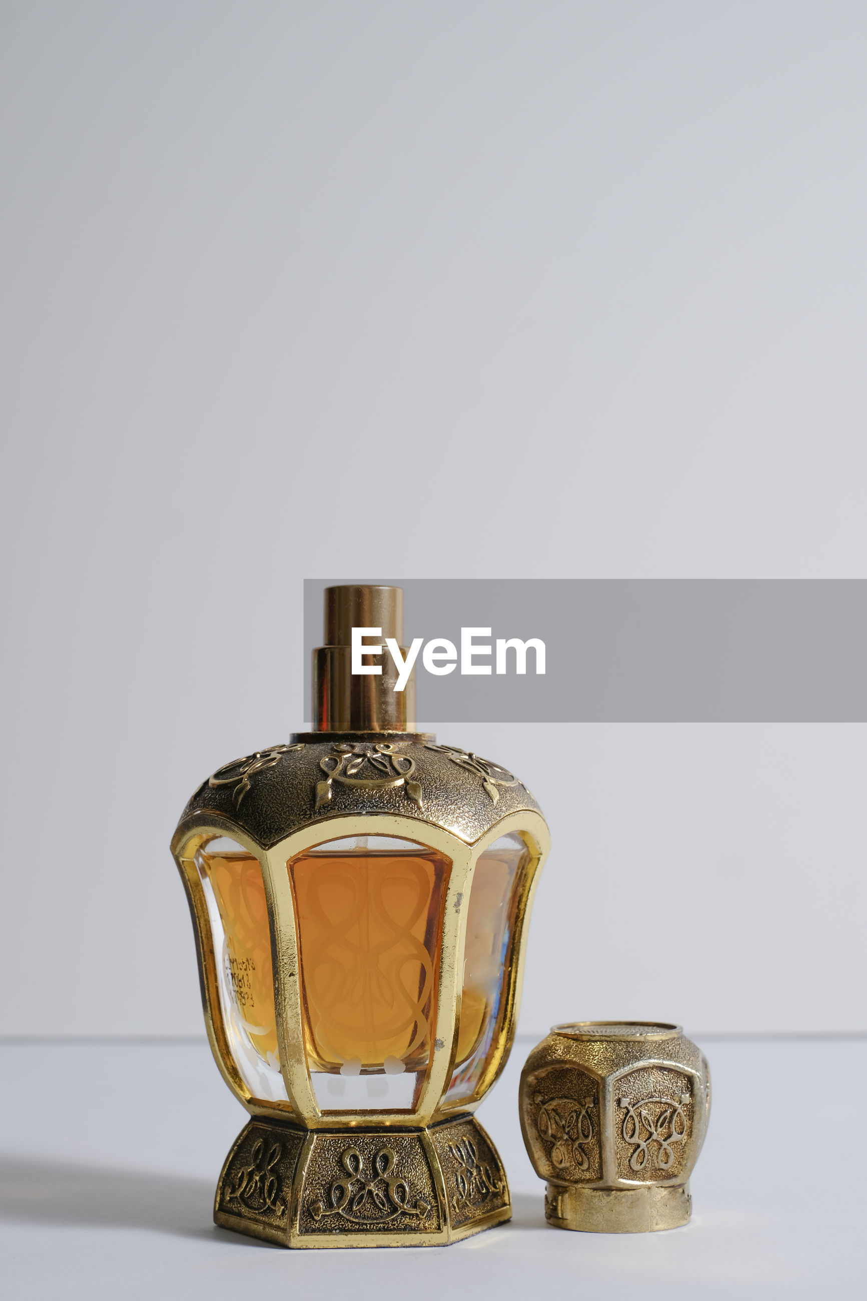 Close-up of antique perfume sprayer against gray background