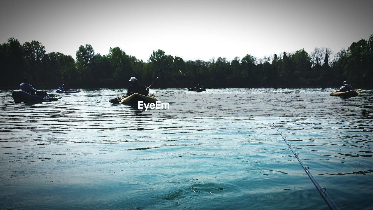 People Fishing At Lake