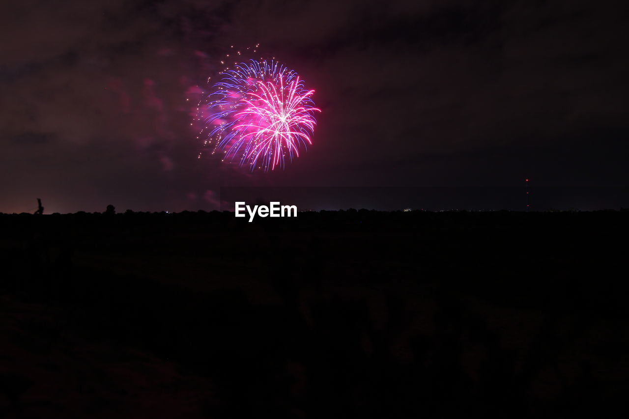 sky, exploding, firework display, night, silhouette, celebration, firework - man made object, low angle view, landscape, outdoors, no people, scenics, arts culture and entertainment, beauty in nature, nature, illuminated