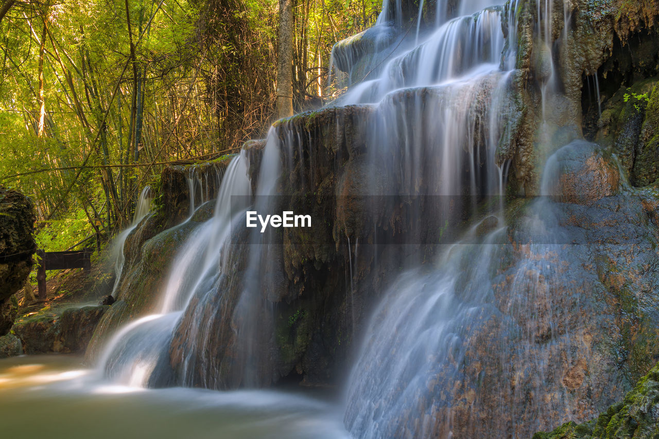 waterfall, long exposure, scenics - nature, forest, tree, beauty in nature, water, blurred motion, flowing water, motion, land, plant, nature, environment, no people, flowing, rock, rock - object, non-urban scene, power in nature, rainforest, outdoors, falling water, woodland, stream - flowing water