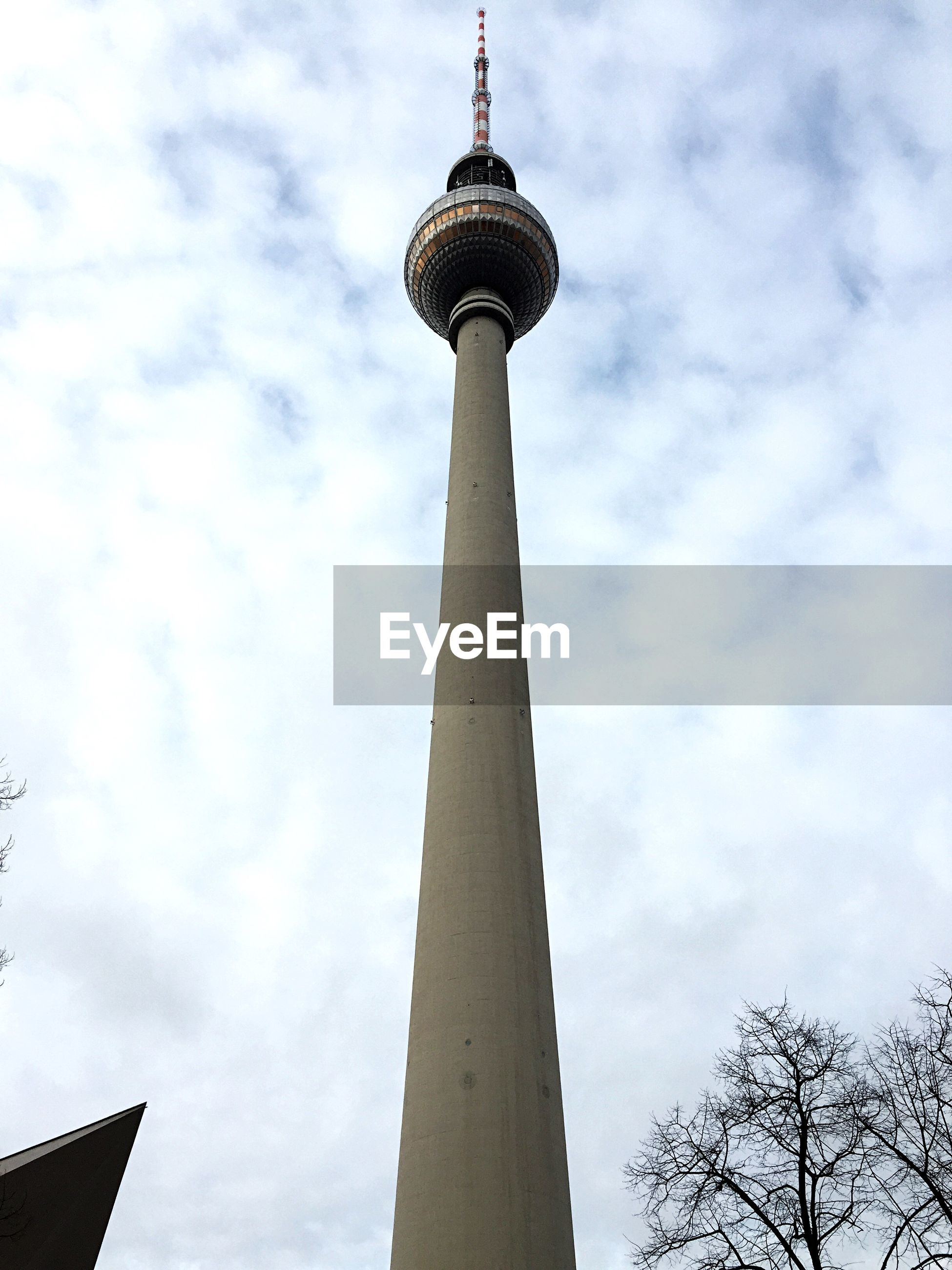 tower, tall - high, international landmark, communications tower, architecture, low angle view, built structure, famous place, sky, travel destinations, tourism, capital cities, communication, building exterior, travel, culture, cloud - sky, television tower, spire, fernsehturm