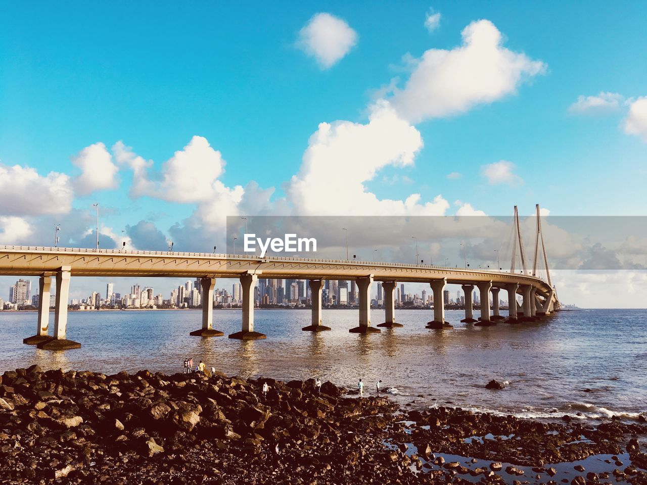 sky, cloud - sky, water, sea, built structure, nature, bridge, architecture, connection, scenics - nature, beauty in nature, beach, tranquil scene, day, no people, bridge - man made structure, tranquility, pier, land, architectural column