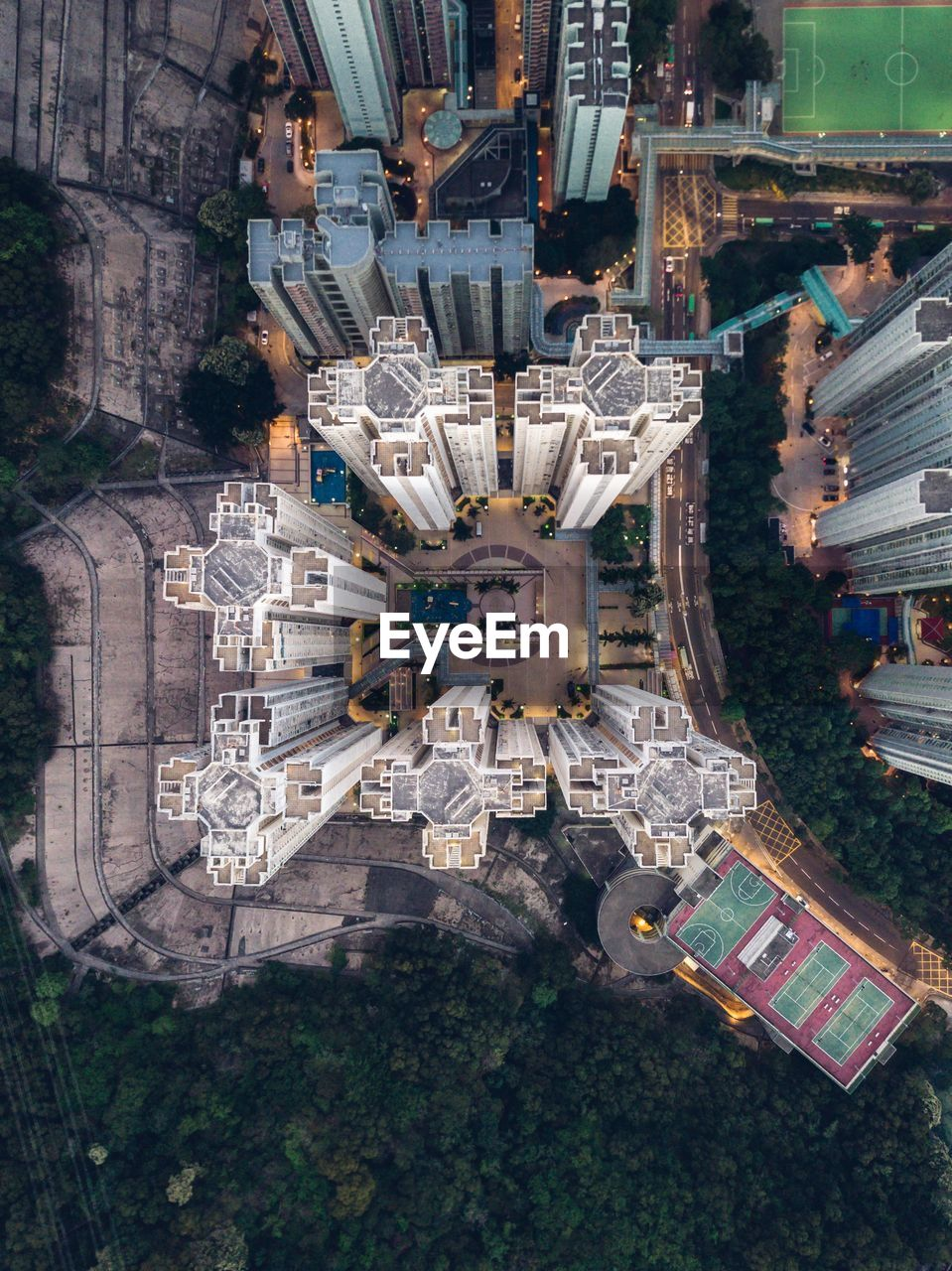 architecture, city, building exterior, built structure, cityscape, building, high angle view, aerial view, travel destinations, directly above, outdoors, nature, day, tree, transportation, no people, digital composite, mode of transportation, town, office building exterior, skyscraper