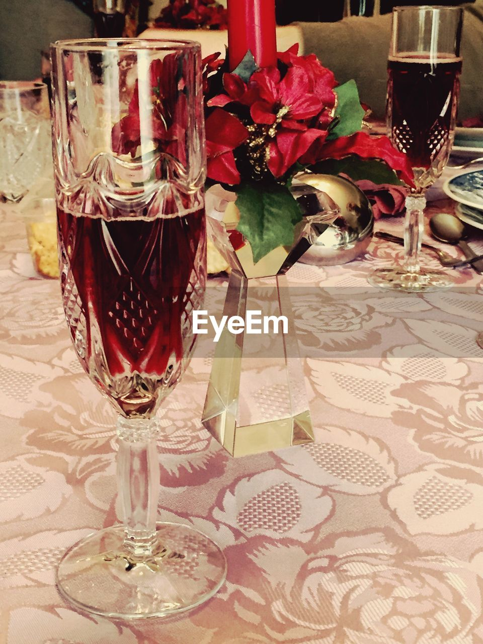 wineglass, wine, table, drink, alcohol, drinking glass, food and drink, red wine, glass, refreshment, indoors, place setting, alcoholic drink, no people, flower, beverage, vase, champagne, plate, freshness, red, close-up, food, day