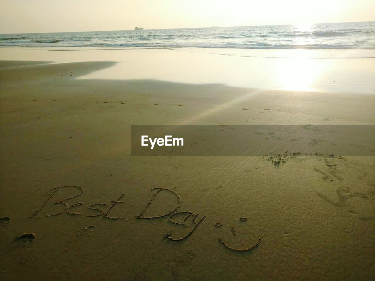 beach, sea, sand, horizon over water, text, nature, no people, beauty in nature, water, outdoors, day, close-up