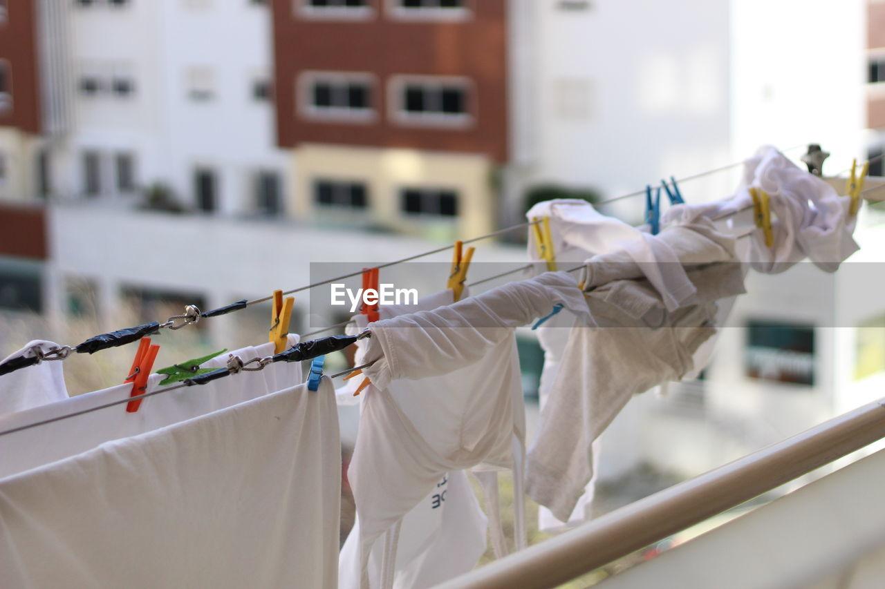 White Laundry Drying On Clothesline