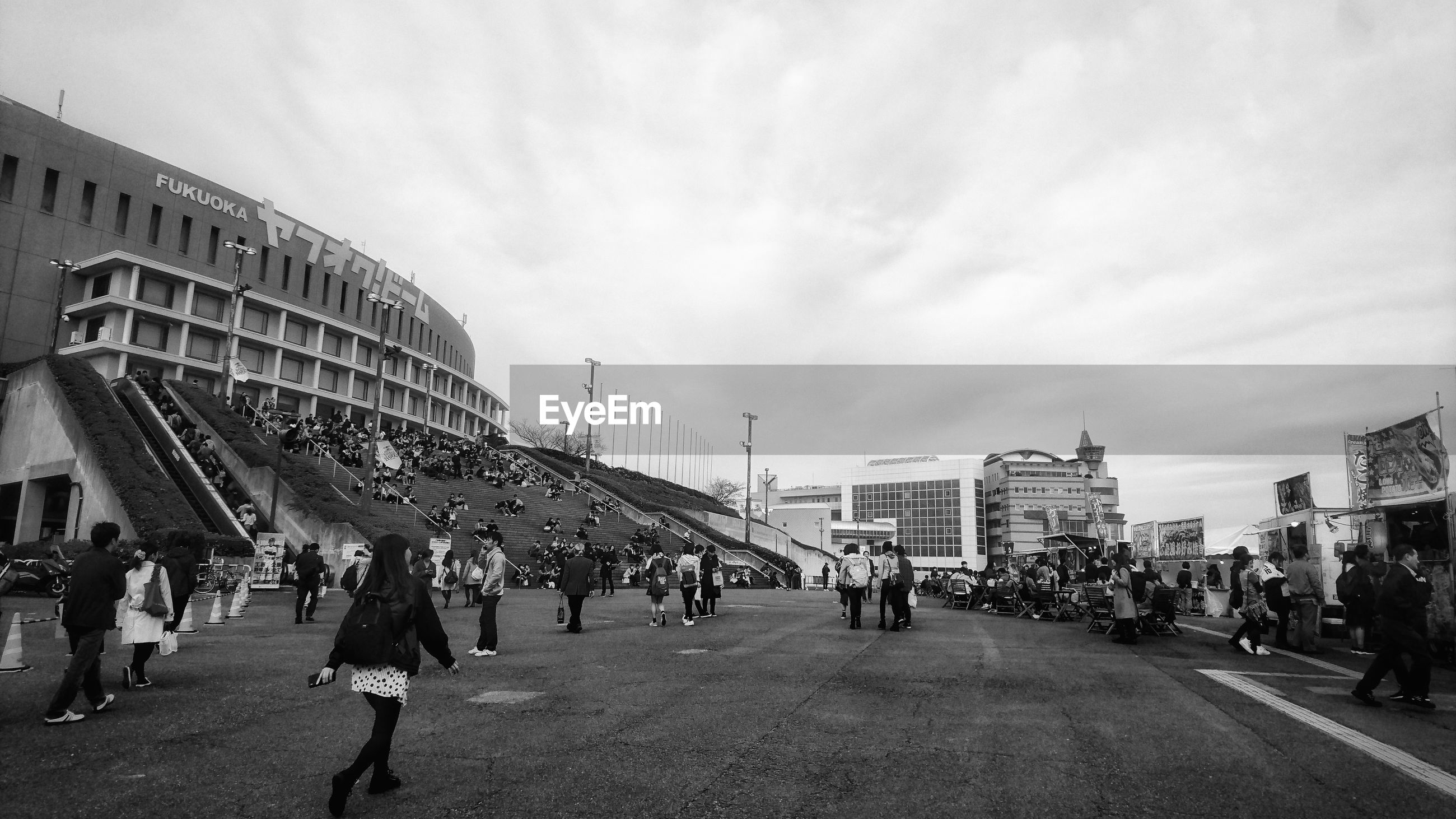 large group of people, walking, women, sky, city, built structure, men, building exterior, cloud - sky, real people, architecture, outdoors, people, adults only, day, adult, bridge - man made structure, crowd