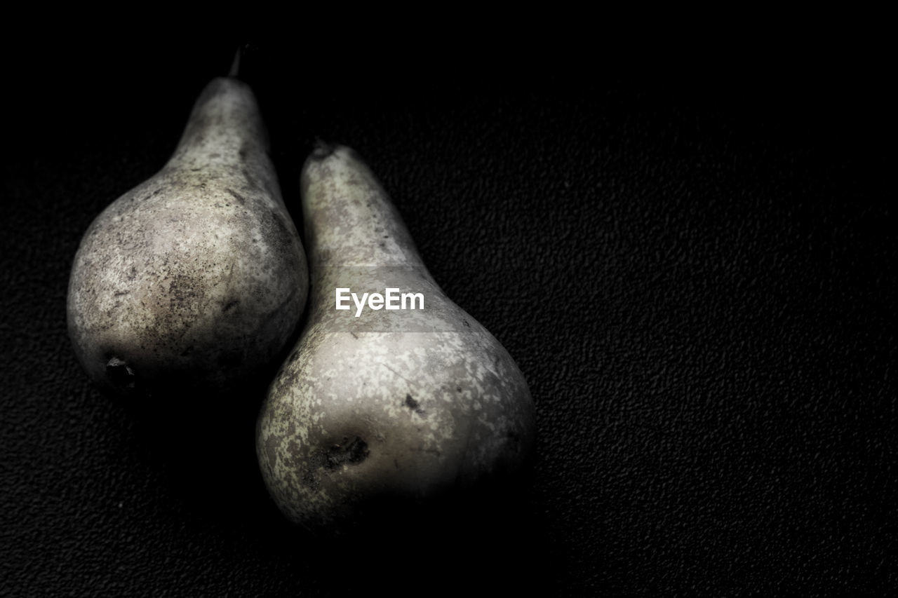 Close-Up Of Pears On Black Background