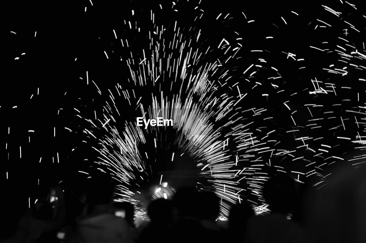 night, illuminated, firework display, celebration, motion, firework, event, exploding, arts culture and entertainment, long exposure, blurred motion, glowing, low angle view, nature, selective focus, smoke - physical structure, no people, firework - man made object, outdoors, sparks, light, nightlife