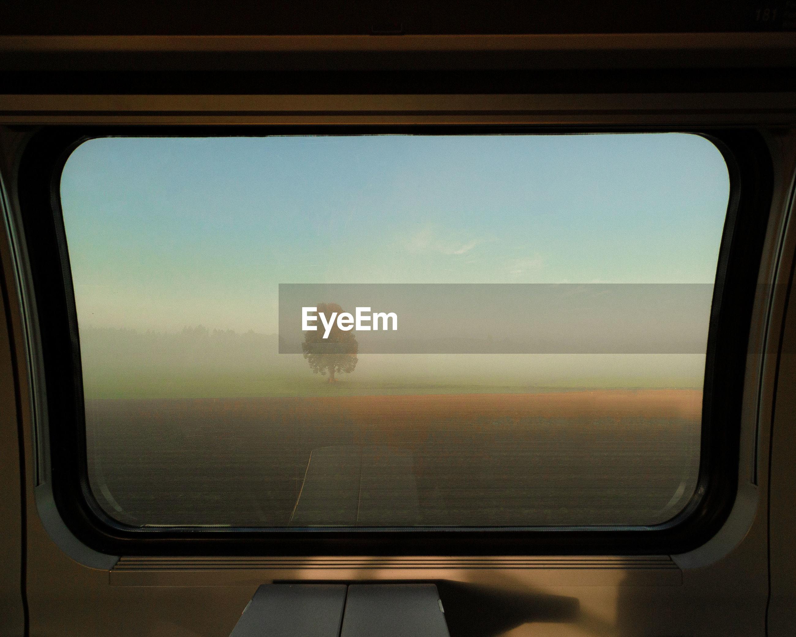 Scenic view seen through train window