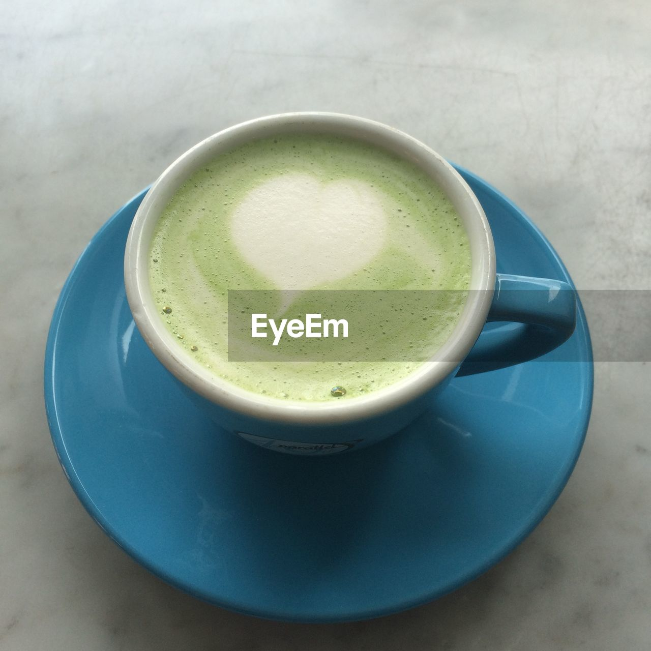High angle view of matcha tea in cup on table