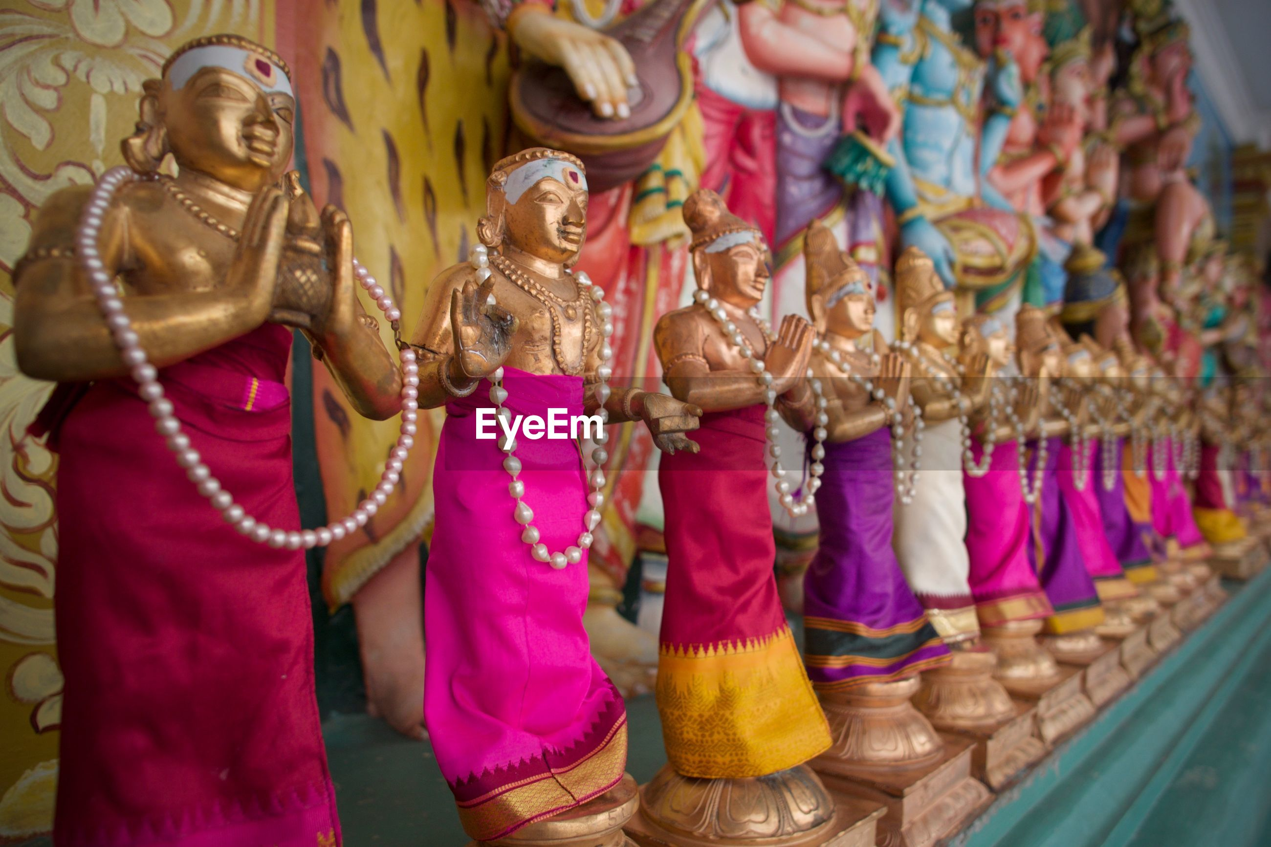 LOW ANGLE VIEW OF STATUES AT TEMPLE