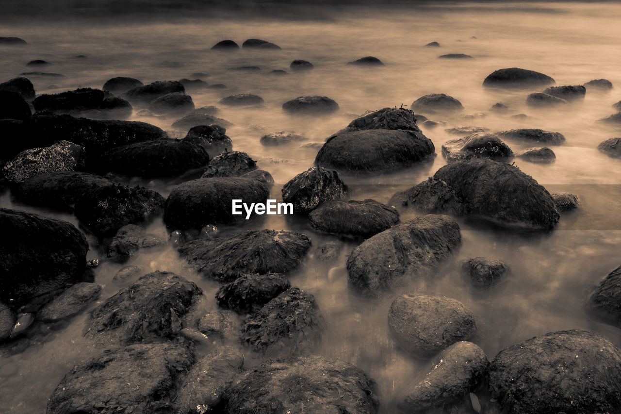 rock, solid, rock - object, no people, beauty in nature, water, sea, scenics - nature, nature, land, motion, sunset, long exposure, sky, cloud - sky, outdoors, beach, day, tranquility