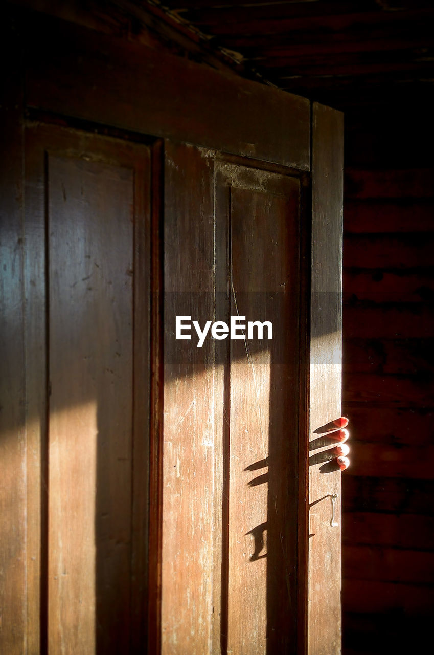 wood - material, indoors, close-up, no people, architecture, door, entrance, sunlight, building, day, shadow, built structure, wood, brown, old, pattern, nature, house, closed