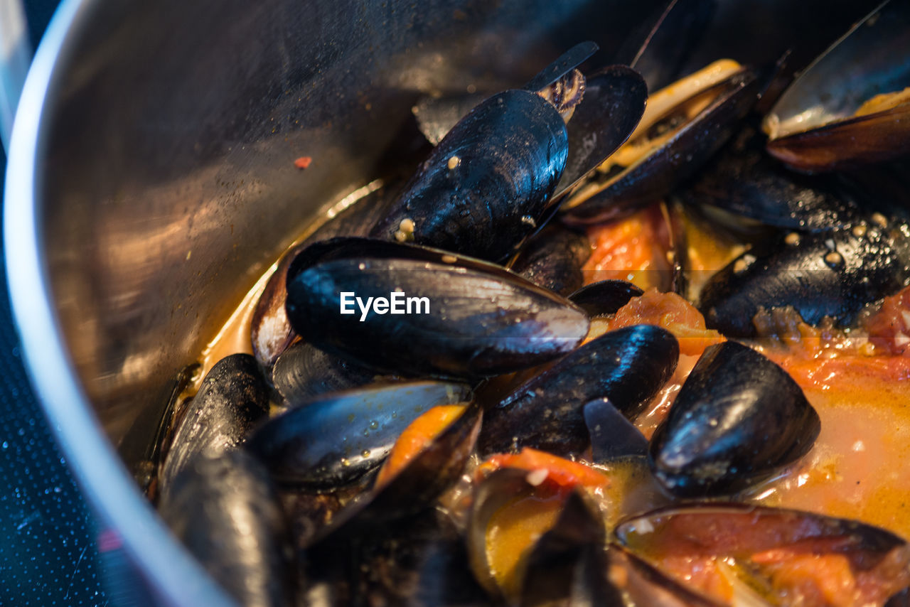 Close-Up Of Cooked Mussels In Utensil