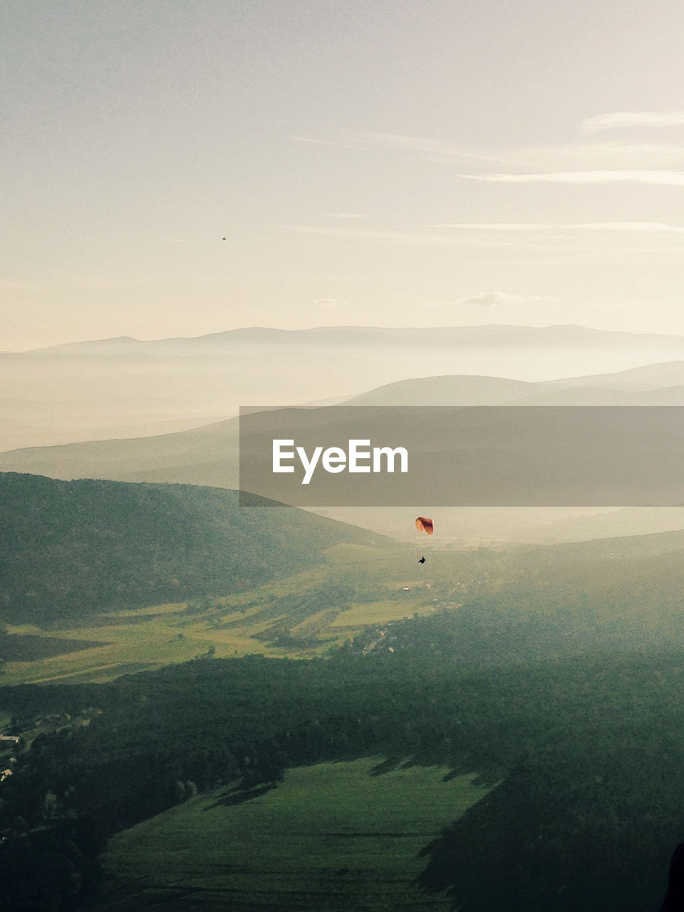 SCENIC VIEW OF HOT AIR BALLOON FLYING OVER LANDSCAPE
