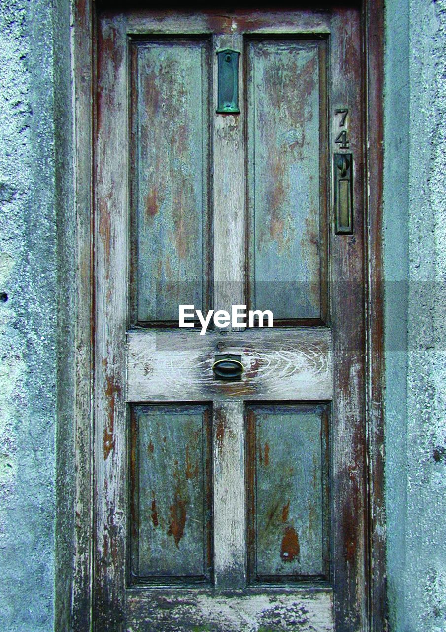 door, full frame, outdoors, day, close-up, no people, backgrounds