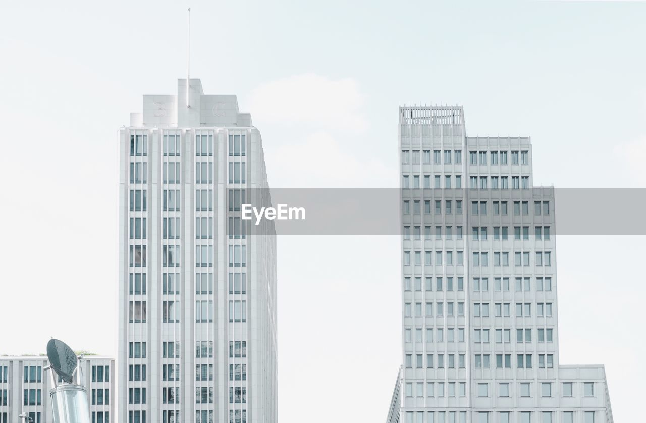 built structure, building exterior, architecture, city, building, sky, office building exterior, tall - high, office, day, skyscraper, modern, no people, window, low angle view, nature, tower, outdoors, cloud - sky, residential district, apartment