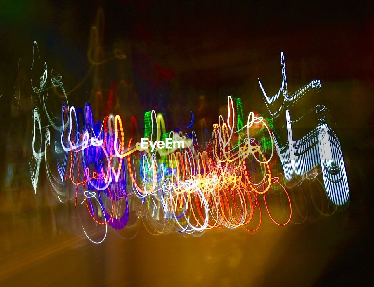 illuminated, multi colored, glowing, long exposure, night, motion, light - natural phenomenon, no people, light trail, light, blurred motion, light painting, electric light, close-up, pattern, lighting equipment, speed, focus on foreground, abstract, indoors, complexity