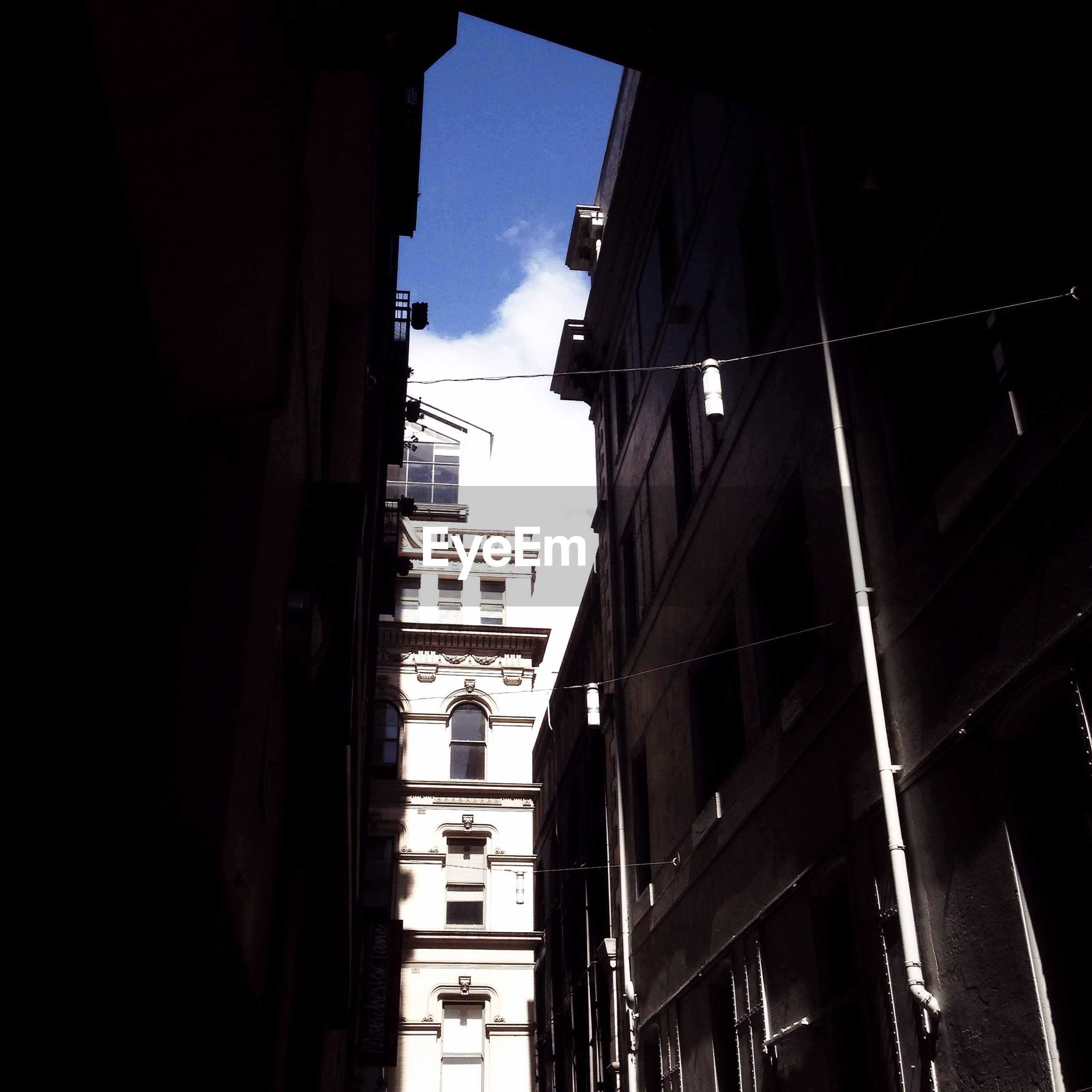 building exterior, architecture, built structure, city, low angle view, building, residential building, sky, residential structure, street, window, city life, street light, outdoors, no people, day, residential district, house, transportation, city street