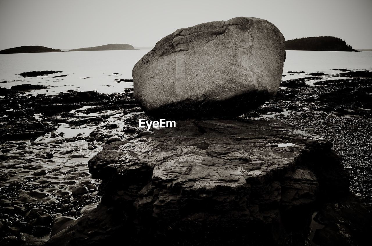 rock - object, nature, rock formation, rock, tranquility, outdoors, tranquil scene, beauty in nature, day, mountain, water, cliff, sea, no people, scenics, beach, clear sky, sky, close-up