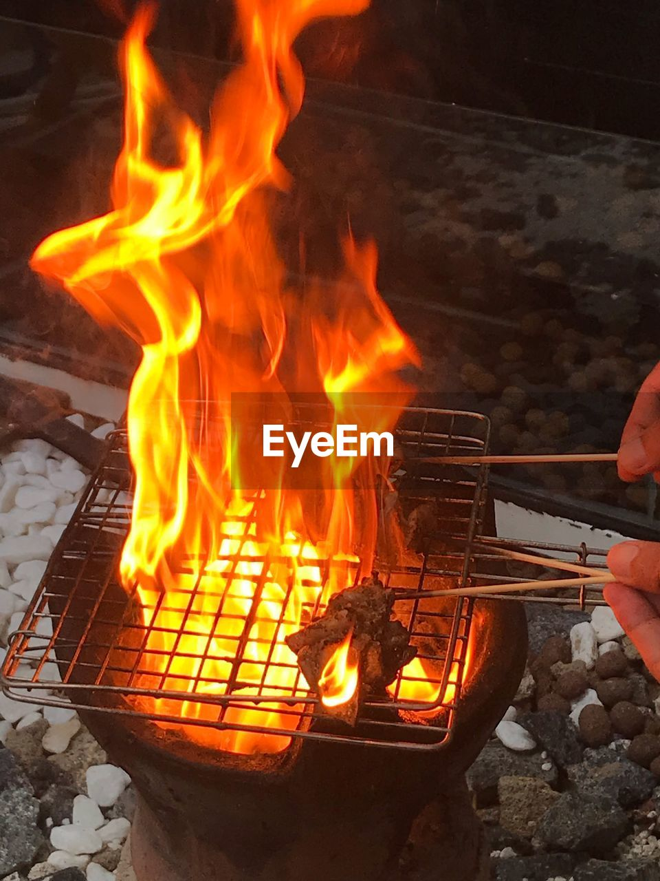 heat - temperature, fire, burning, fire - natural phenomenon, flame, human hand, real people, hand, food, one person, food and drink, nature, human body part, holding, preparation, unrecognizable person, barbecue, body part, orange color, outdoors, finger, bonfire, preparing food, campfire