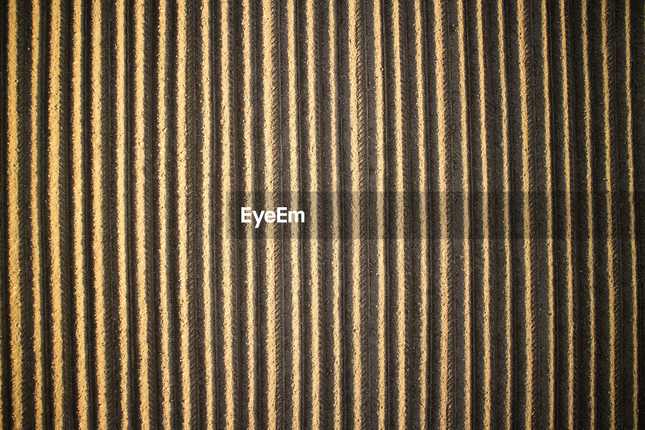 backgrounds, pattern, full frame, textured, no people, striped, close-up, textile, brown, repetition, indoors, day, metal, in a row, material, abstract, simplicity, nature, textured effect
