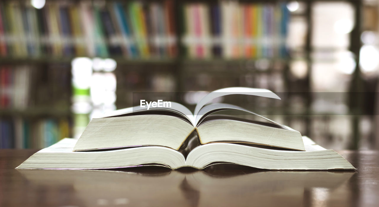 book, publication, education, learning, open, page, literature, paper, still life, focus on foreground, indoors, close-up, table, wisdom, expertise, no people, shelf, bookshelf, selective focus, library, studying, hardcover book, surface level, textbook
